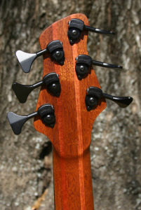 The neck is is a 5-layer neck made from mahogany and bubinga