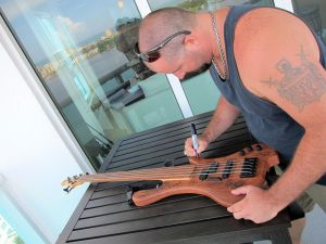 Eric Lee Beddingfield is signing the 2013 Charity Bass.
